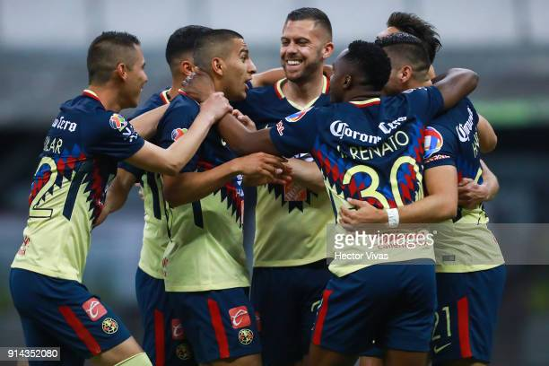 Henry Martin of America celebrates with teammates after scoring the third goal of his team during the 5th round match between America and Lobos BUAP...