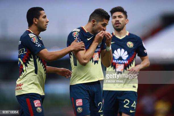 Henry Martin of America celebrates with teammates after scoring the second goal of his team during the match between America and Tauro FC as part of...