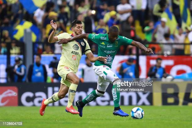 Henry Martin of America struggles for the ball against Andres Mosquera of Leon during the 6th round match between America and Leon as part of the...
