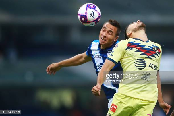 Henry Martin of America struggles for the ball with Carlos Rodriguez of Puebla during the 15th round match between America and Puebla as part of the...