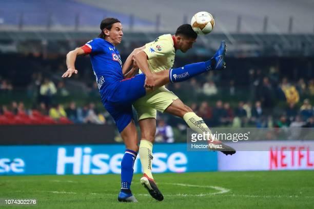 Henry Martin of America struggles for the ball with Igor Lichnovsky of Cruz Azul during the final second leg match between Cruz Azul and America as...