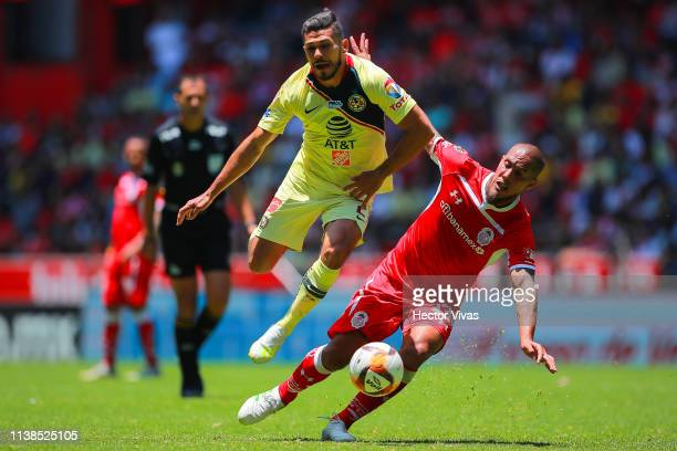Henry Martin of America struggles for the ball with Jonatan Maidana of Toluca during the 15th round match between Toluca and America as part of the...