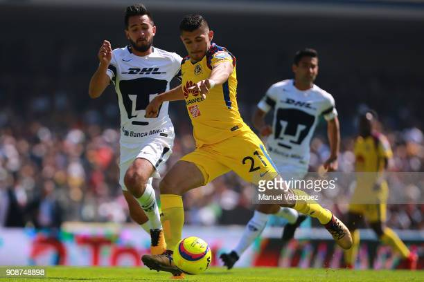 Henry Martin of America struggles for the ball with Luis Quintana of Pumas during the 3rd round match between Pumas UNAM and America as part of the...