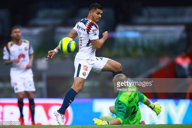 Henry Martin of America struggles for the ball with Manuel Lajud goalkeeper of Tijuana during the 9th round match between America and Tijuana as part...