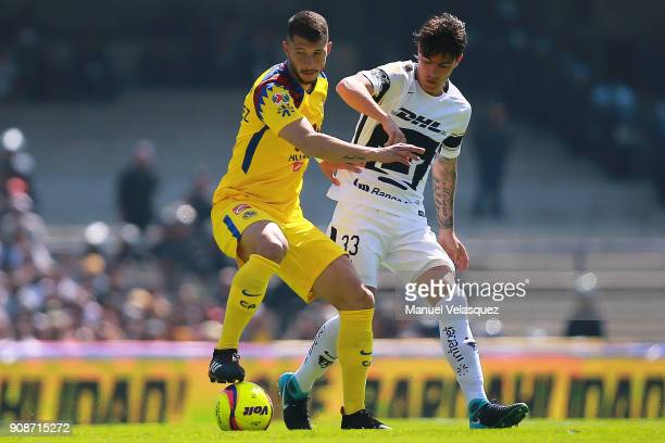 Henry Martin of America struggles for the ball with Mauro Formica of Pumas during the 3rd round match between Pumas UNAM and America as part of the...