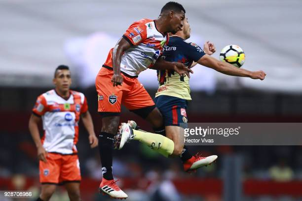 Henry Martin of America struggles for the ball with Richard Dixon of Tauro FC during the match between America and Tauro FC as part of the CONCACAF...