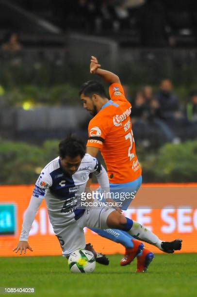 Henry Martin of America vies for the ball with Jorge Hernandez of Pachuca during the Mexican Clausura 2019 tournament football match at the Azteca...