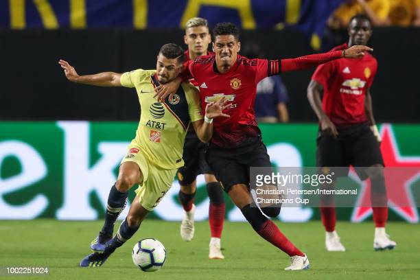 Henry Martin of Club America and Chris Smalling of Manchester United battle for the ball during the International Champions Cup game at the...