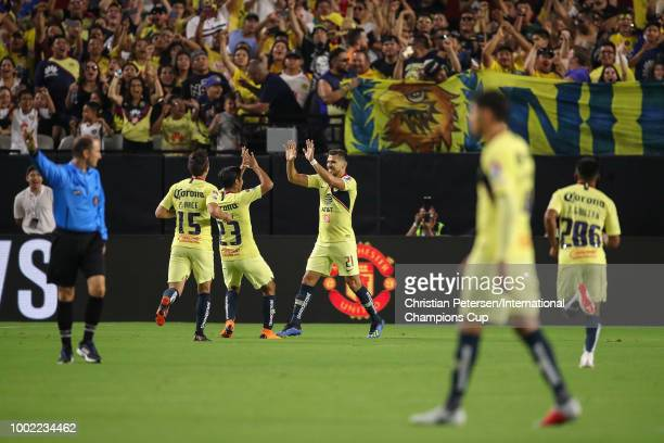 Henry Martin of Club America celebrates a goal with teammates during the International Champions Cup game against the Manchester United at the...