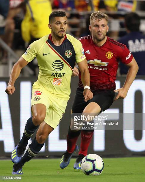 Henry Martin of Club America controls the ball past Luke Shaw of Manchester United during the International Champions Cup game at the University of...