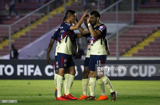 Henry Martin of Mexican team America celebrates with teammates after scoring against Panama's Tauro during the second leg match of the Concacaf...