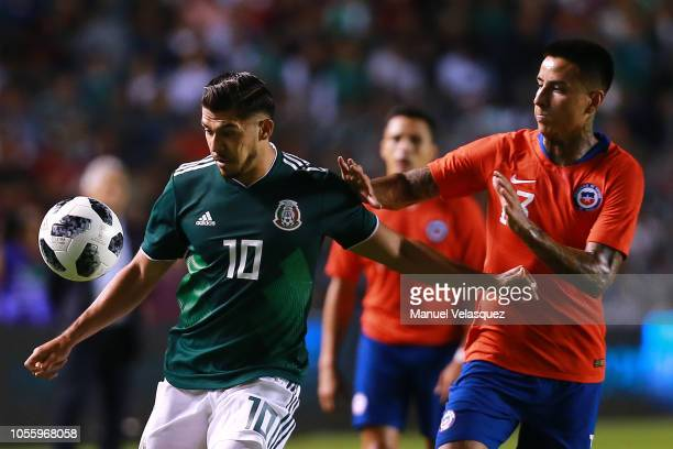 Henry Martin of Mexico struggles for the ball against Erick Pulgar of Chile during the international friendly match between Mexico and Chile at La...