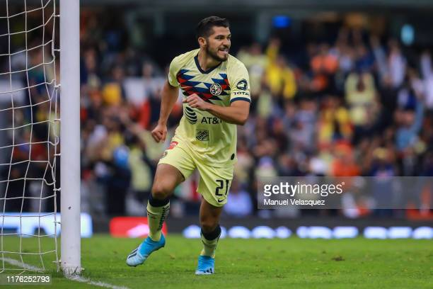 Henry Martín of America celebrates his first scored goal during the 10th round match between America and Queretaro as part of the Torneo Apertura...