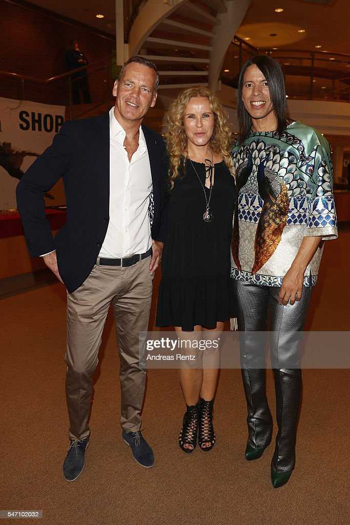 Henry Maske, Katja Burkard and Jorge Gonzalez arrives for the Ballet Revolucion show premiere at the Philharmonie on July 13, 2016 in Cologne, Germany.