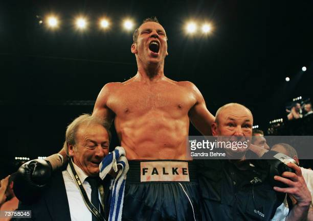 Henry Maske of Germany celebrates with his manager Werner Heinz and his coach Manfred Wolke his victory against Virgil Hill after their Cruiserweight...