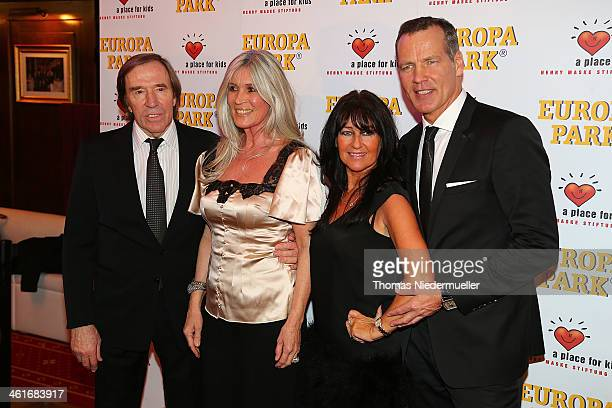 Henry Maske pose with his wife Mauela Elvira Lang Netzer and Guenther Netzer during his 50th birthday at Europapark on January 10 2014 in Rust Germany
