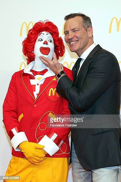 Henry Maske poses with Ronald McDonald during the new McDonald's Flagship Restaurant reopening at Frankfurt International Airport Terminal 2 on March...