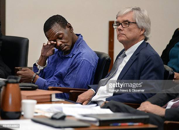Henry McCollum wiles away tears as he sits next to his attorney Richard Johnston at the Robeson County Courthouse in Lumberton NC Tuesday Sept 2 2014...