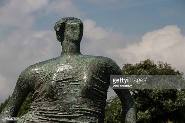 Henry Moore draped seated woman.1957-58. Bronze.in the grounds of The Yorkshire Sculpture Park,near leads,UK.