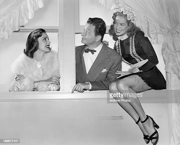 Henry Morgan enjoying the company of Virginia Grey and Dona Drake in a scene from the film 'So This Is New York' 1948