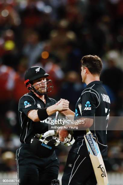 Henry Nicholls and Colin de Grandhomme of New Zealand celebrate after winning game four of the One Day International Series between New Zealand and...