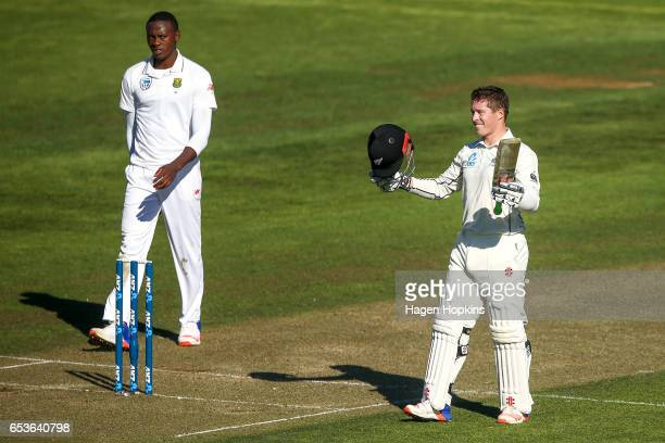 Henry Nicholls of New Zealand celebrates his maiden test century while Kagiso Rabada of South Africa looks on during day one of the Test match...