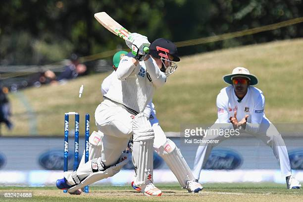Henry Nicholls of New Zealand gets bowled for 98 after he bats the ball onto his own stumps during day four of the Second Test match between New...
