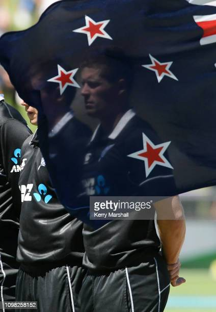 Henry Nicholls of New Zealand lines up for the national anthems before game one of the One Day International series between New Zealand and India at...