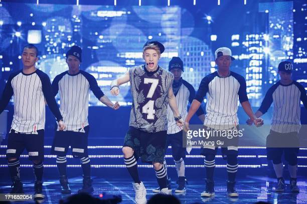 Henry of boy band Super Junior M performs onstage during the Mnet 'M CountDown' at CJ E&M Center on June 27, 2013 in Seoul, South Korea.