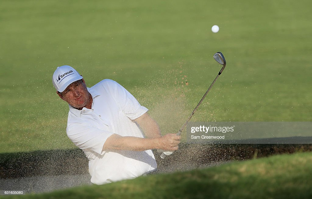 J.J. Henry of the United States plays a shot from a bunker on the 18th hole during the second round of the Sony Open In Hawaii at Waialae Country Club on January 13, 2017 in Honolulu, Hawaii.