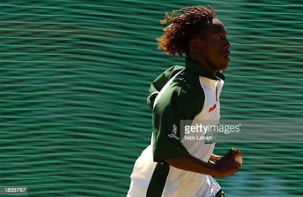 Henry Olonga of Zimbabwe bowls during nets ahead of the Cricket World Cup Super Six match between New Zealand and Zimbabwe held at Goodyear Park in...