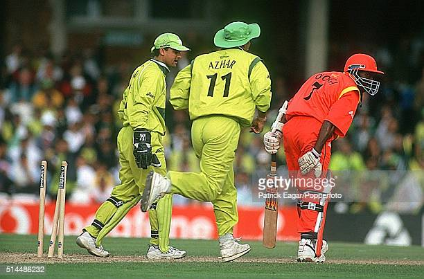 Henry Olonga of Zimbabwe is stumped by Moin Khan of Pakistan off the bowling of Saqlain Mushtaq the first wicket of a hat-trick - during the ICC...