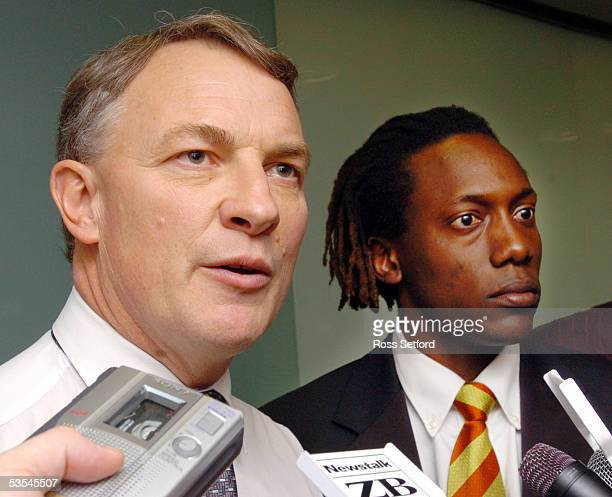 Henry Olonga, right, former Zimbabwean cricket player with Minister of Foreign Affairs Phil Goff at Parliament, Wellington, New Zealand, Thursday,...