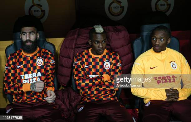 Henry Onyekuru and Jimmy Durmaz watch the match from the players' bench during Turkish Super Lig soccer match between Galatasaray and Hes Kablo...