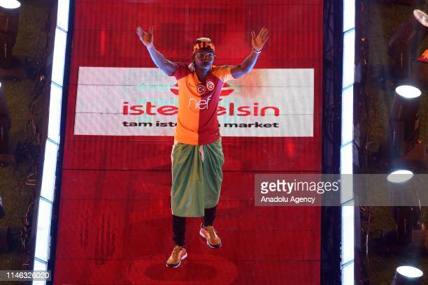 Henry Onyekuru greets fans during the celebrations at Turk Telekom Stadium after winning title for 22nd time in 61st season of the league in Istanbul...