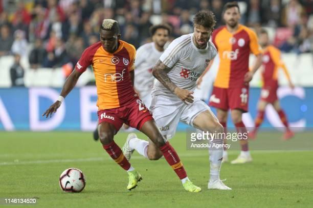 Henry Onyekuru of Galatasaray in action against Mattias Bjarsmyr during Turkish Super Lig match between Demir Grup Sivasspor and Galatasaray at 4...