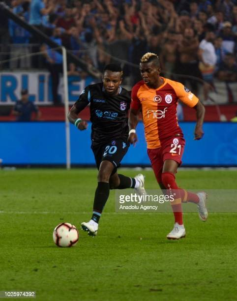 Henry Onyekuru of Galatasaray in action against Ogenyi Onazi of Trabzonspor during Turkish Super Lig soccer match between Trabzonspor and Galatasaray...