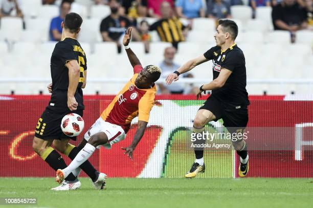 Henry Onyekuru of Galatasaray in action with Vassilis Lampropoulos of AEK Athens during friendly football game between AEK Athens and Galatasaray in...