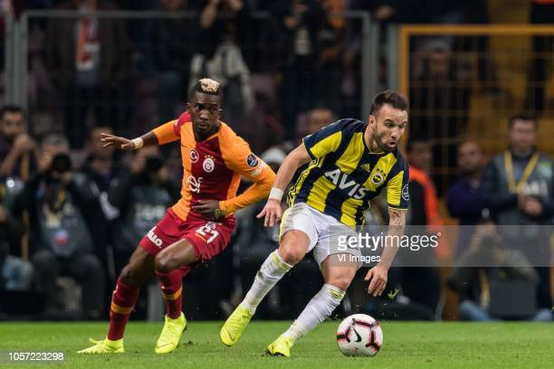 Henry Onyekuru of Galatasaray SK Mathieu Valbuena of Fenerbahce SK during the Turkish Spor Toto Super Lig football match between Galatasaray SK and...