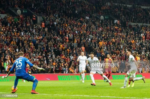 Henry Onyekuru of Galatasaray SK scores goalkeeper Ruud Boffin of Antalyaspor AS Luis Francisco Grando of Antalyaspor AS Diego Angelo de Oliveira of...