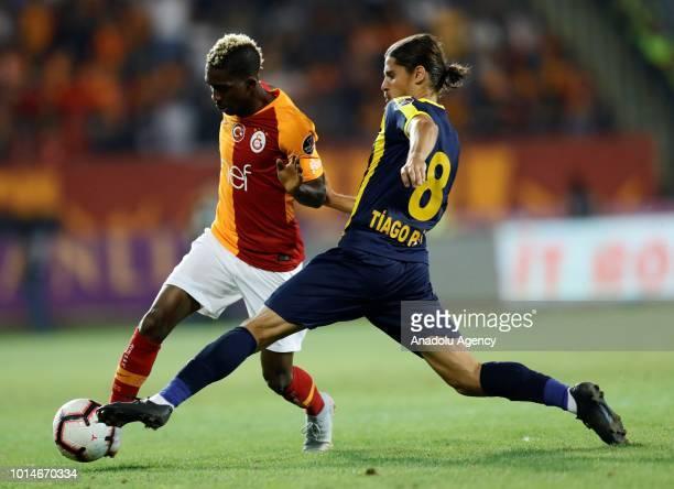 Henry Onyekuru of Galatasaray vies with Tiago Pinto of MKE Ankaragucu during Turkish Super Lig's new season's debut match between MKE Ankaragucu and...