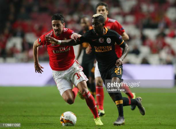 Henry Onyekuru of Galatasaray with Andre Almeida of SL Benfica fighr for the ball during the UEFA Europa League Round of 32 Second Leg match between...