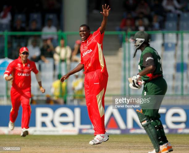 Henry Osinde of Canada celebrates after taking the wicket of David Obuya of Kenya during the ICC Cricket World Cup group A match between Canada and...