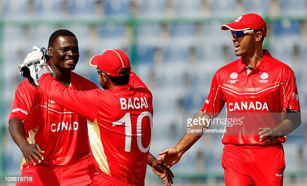 Henry Osinde of Canada celebrates with captain Ahish Bagai after taking the wicket of Morris Ouma of Kenya during the ICC Cricket World Cup group A...