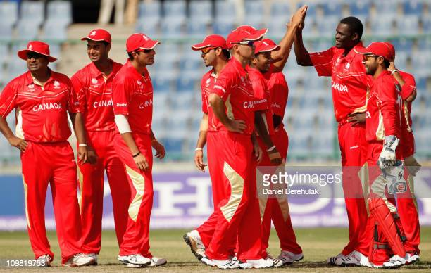 Henry Osinde of Canada celebrates with team mates after taking the wicket of Morris Ouma of Kenya during the ICC Cricket World Cup group A match...