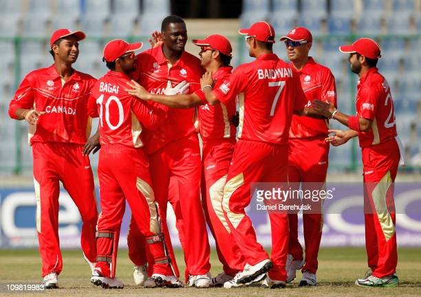 Henry Osinde of Canada celebrates with teammates after bowling Seren Waters of Kenya during the ICC Cricket World Cup group A match between Canada...