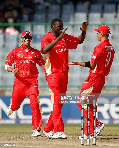 Henry Osinde of Canada celebrates with teammates after taking the wicket of David Obuya of Kenya during the ICC Cricket World Cup group A match...