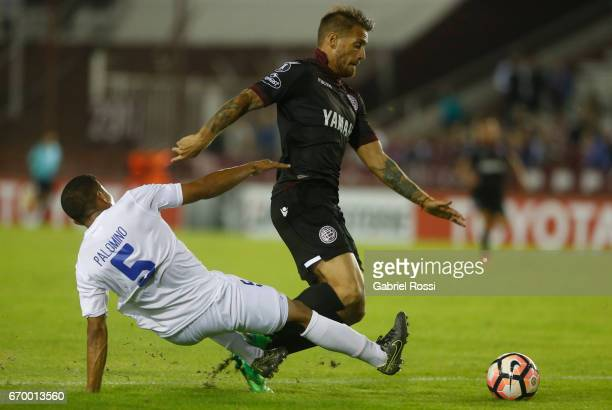 Henry Palomino of Zulia makes a penalty foul over German Denis of Lanus during a group stage match between Lanus and Zulia as part of Copa CONMEBOL...