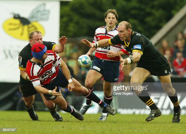 Henry Paul of Gloucester drops the ball as Lawrence Dallaglio looks on during the Heineken Cup Quarter Final match between London Wasps and...