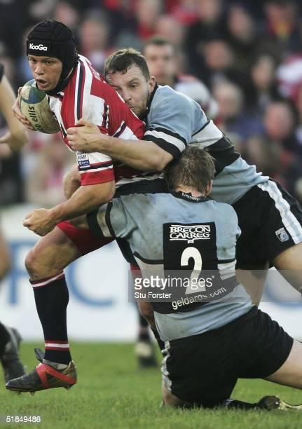 Henry Paul of Gloucester is stopped by the Cardiff defence during the Heineken European Cup Match between Cardiff Blues and Gloucester at Cardiff...